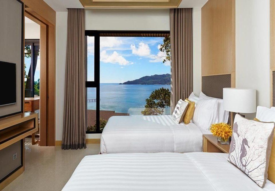 sofa property Suite condominium living room Resort home Villa cottage flat Bedroom