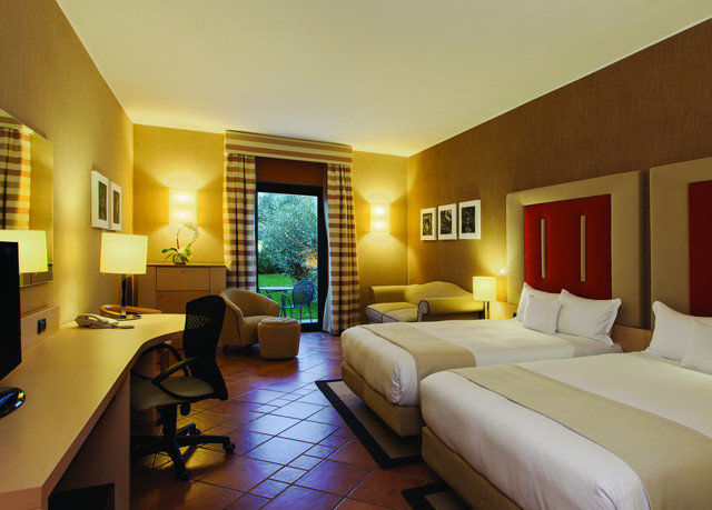 property condominium Suite yellow living room Resort Bedroom home Villa