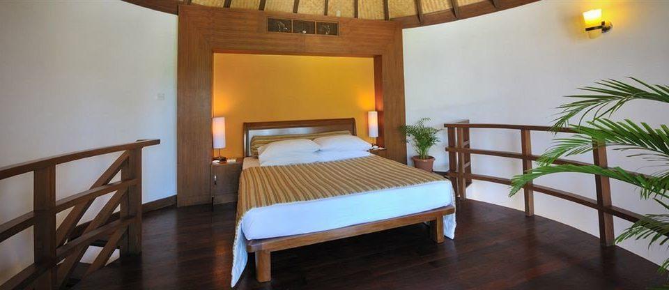 chair property wooden Resort building Villa Suite cottage hacienda eco hotel Bedroom