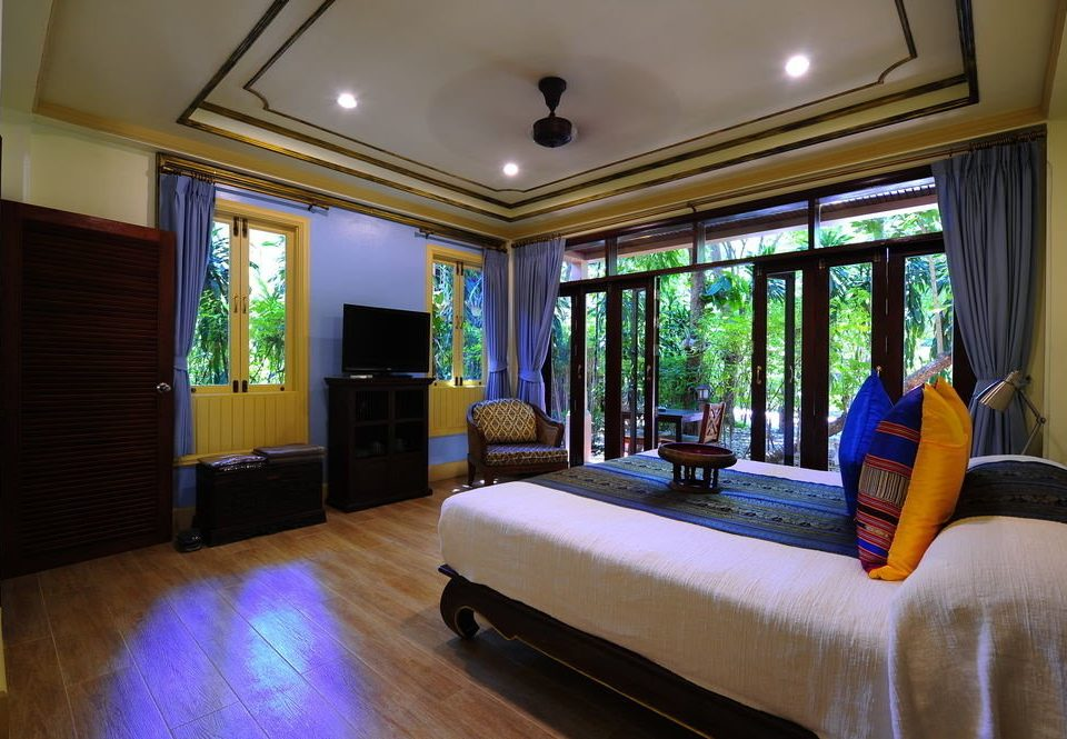 sofa property living room house home Resort condominium Suite mansion Villa Bedroom cottage