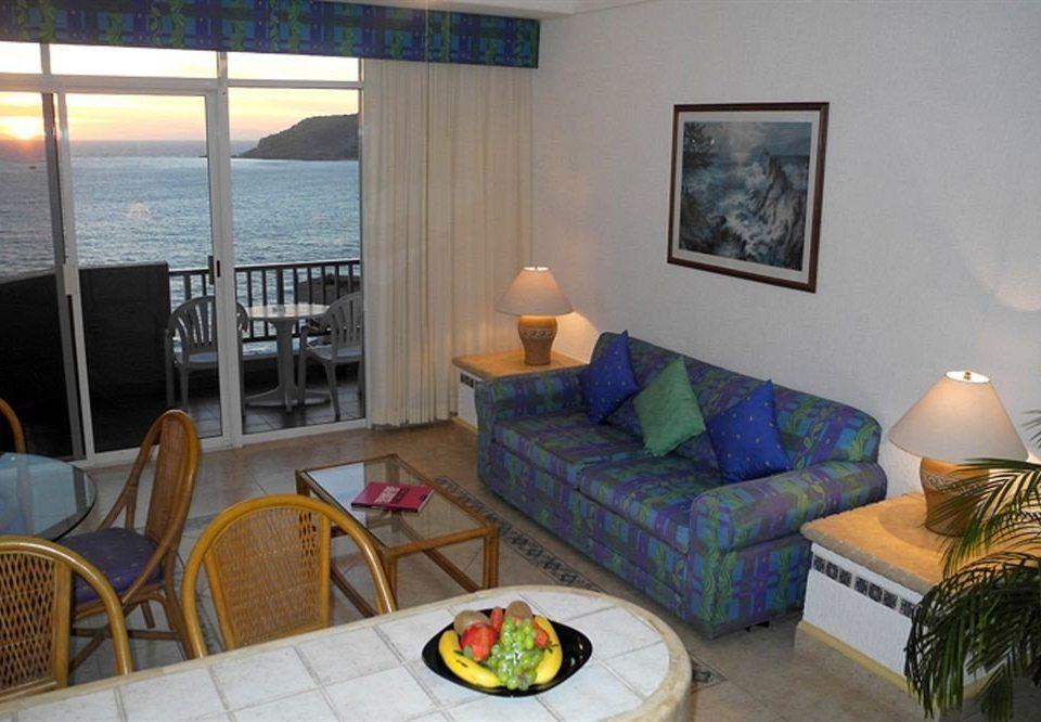 chair property cottage Villa living room home Suite condominium Resort Bedroom
