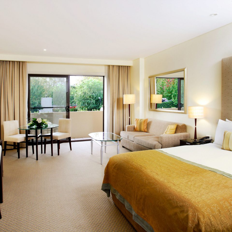 sofa Bedroom property Suite scene living room condominium Villa Resort cottage containing