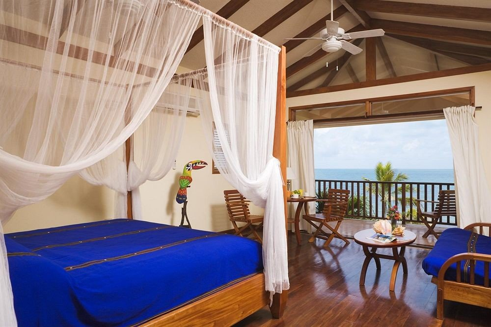 property chair mosquito net curtain blue Resort Suite cottage Bedroom Villa