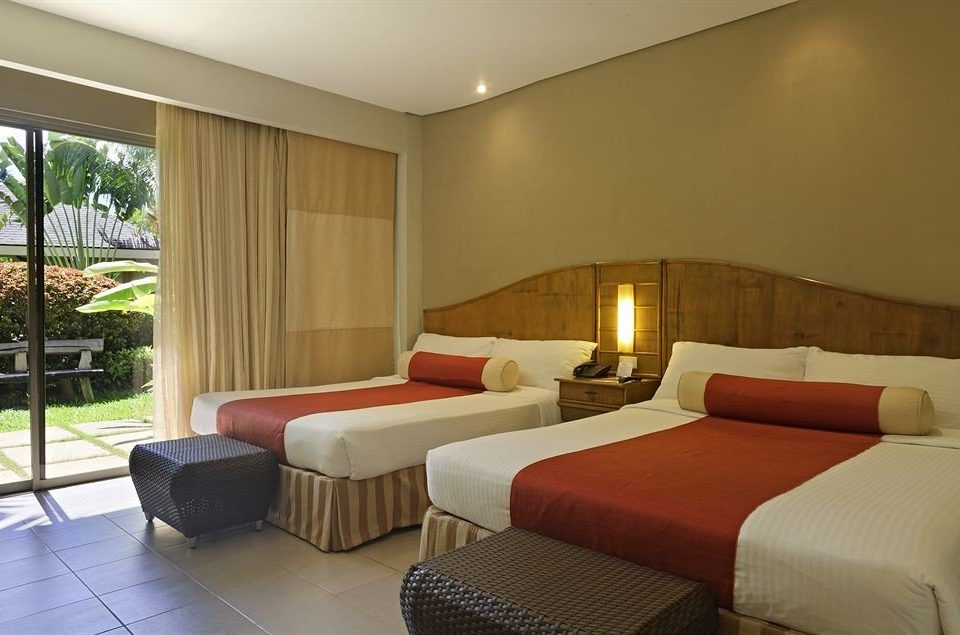 sofa property Bedroom Suite Resort condominium cottage Villa
