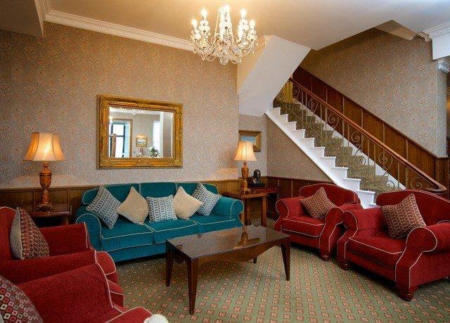 sofa property living room Suite red Villa home cottage Resort condominium Bedroom