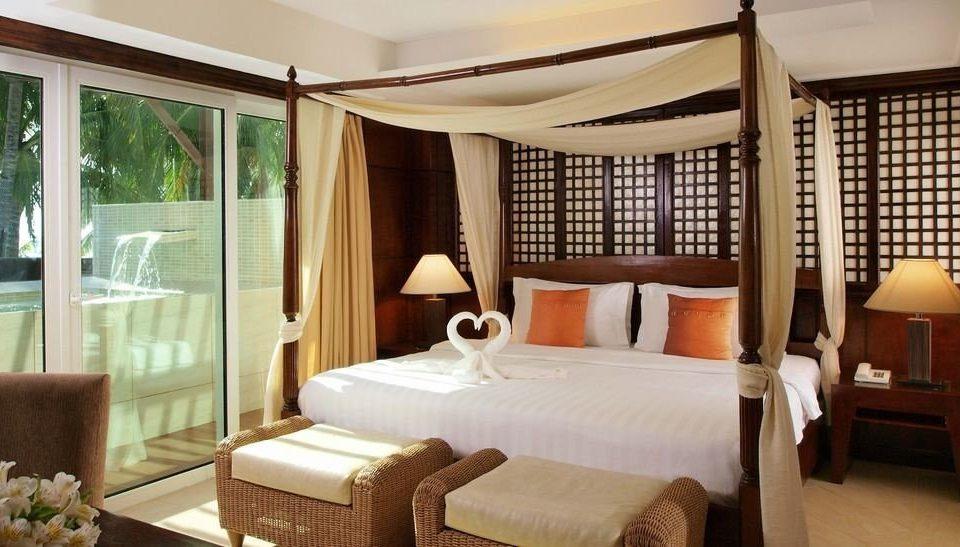 chair property Bedroom Suite Resort condominium living room Villa cottage