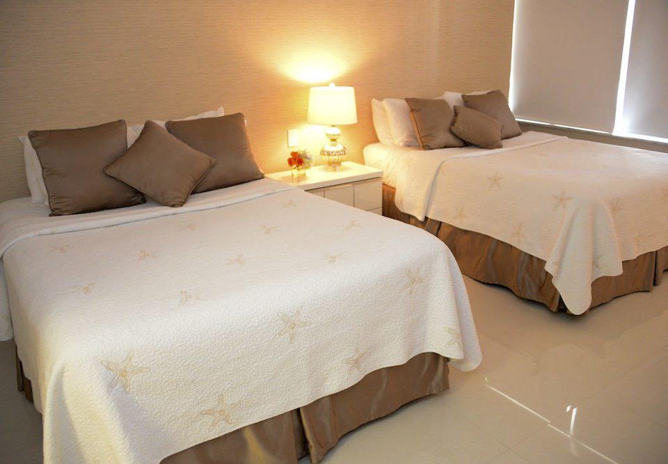 Bedroom Resort Waterfront Suite bed sheet cottage