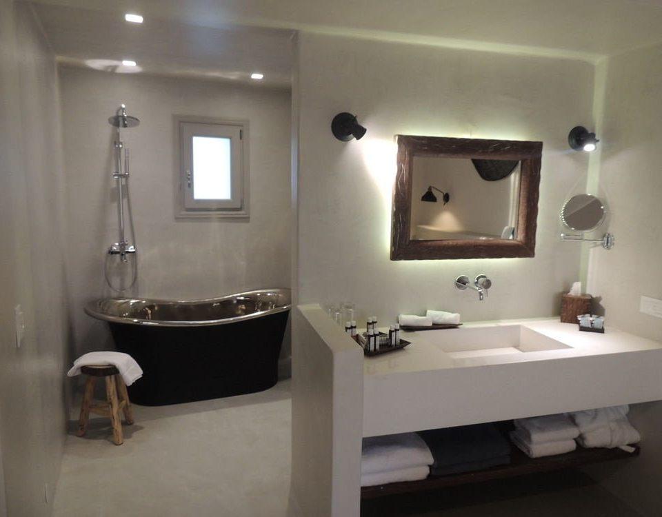 bathroom property mirror sink plumbing fixture home bathtub Suite bidet Bedroom