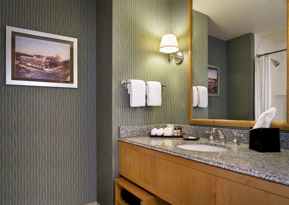 bathroom property sink home Suite cabinetry counter flooring Bedroom