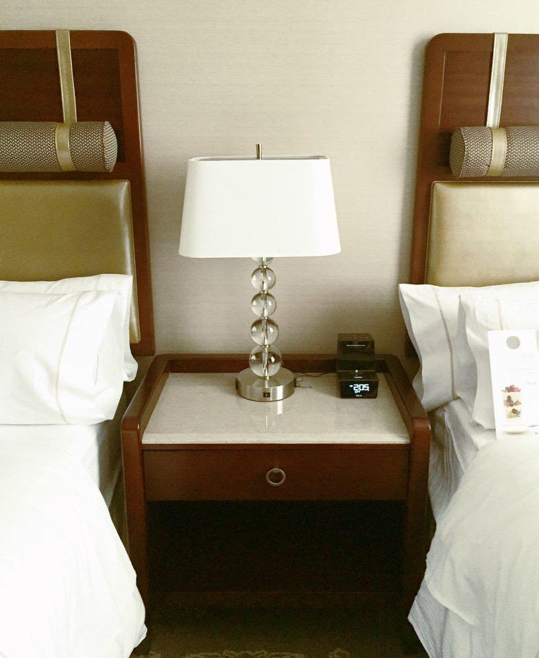 pillow towel lighting white Bedroom bathroom sink Suite textile chair plumbing fixture lamp