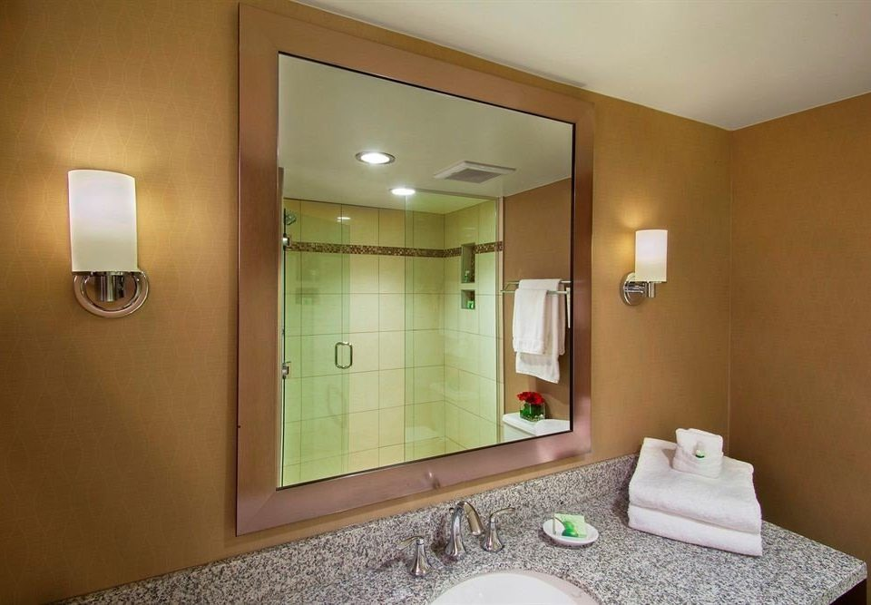 bathroom mirror sink property Suite home condominium Bedroom tan