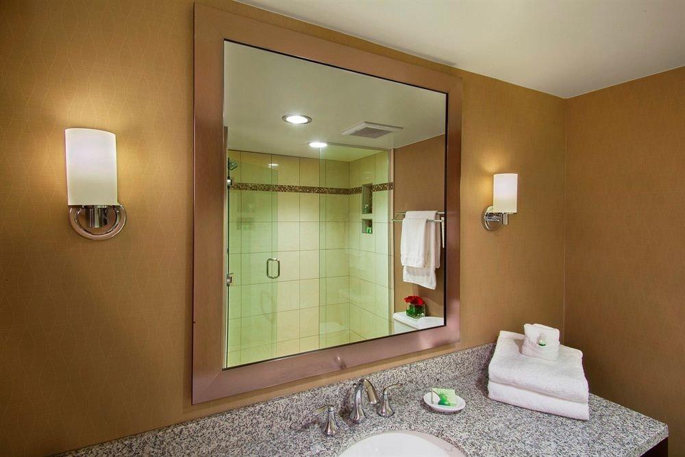 bathroom mirror sink property Suite home condominium Bedroom tan