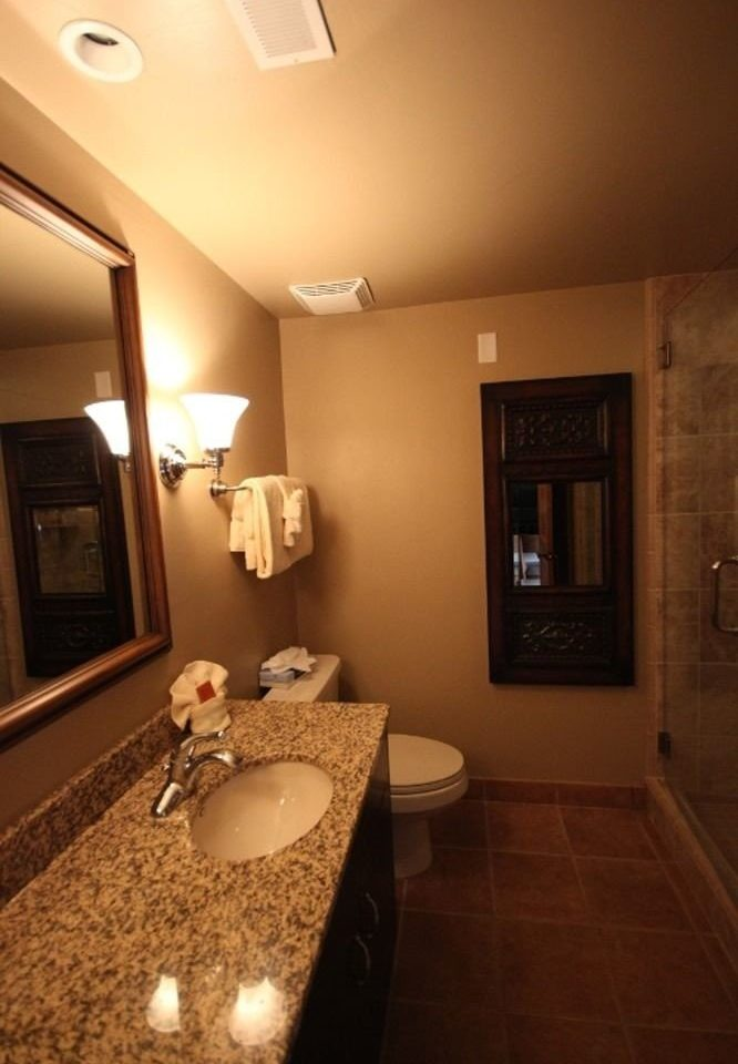 bathroom mirror sink property home toilet hardwood Suite cottage flooring Bedroom tile