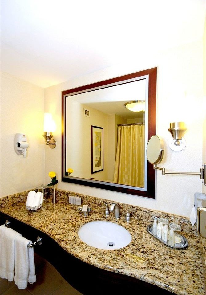 bathroom mirror sink property towel Suite vanity counter home Bedroom flooring rack tan