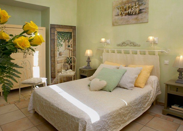 property Bedroom living room green cottage yellow home Suite bed sheet bed frame colored