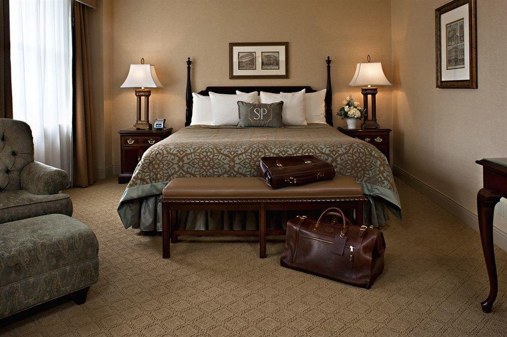 sofa Bedroom property Suite hardwood living room home cottage bed frame lamp flooring wood flooring bed sheet nice tan