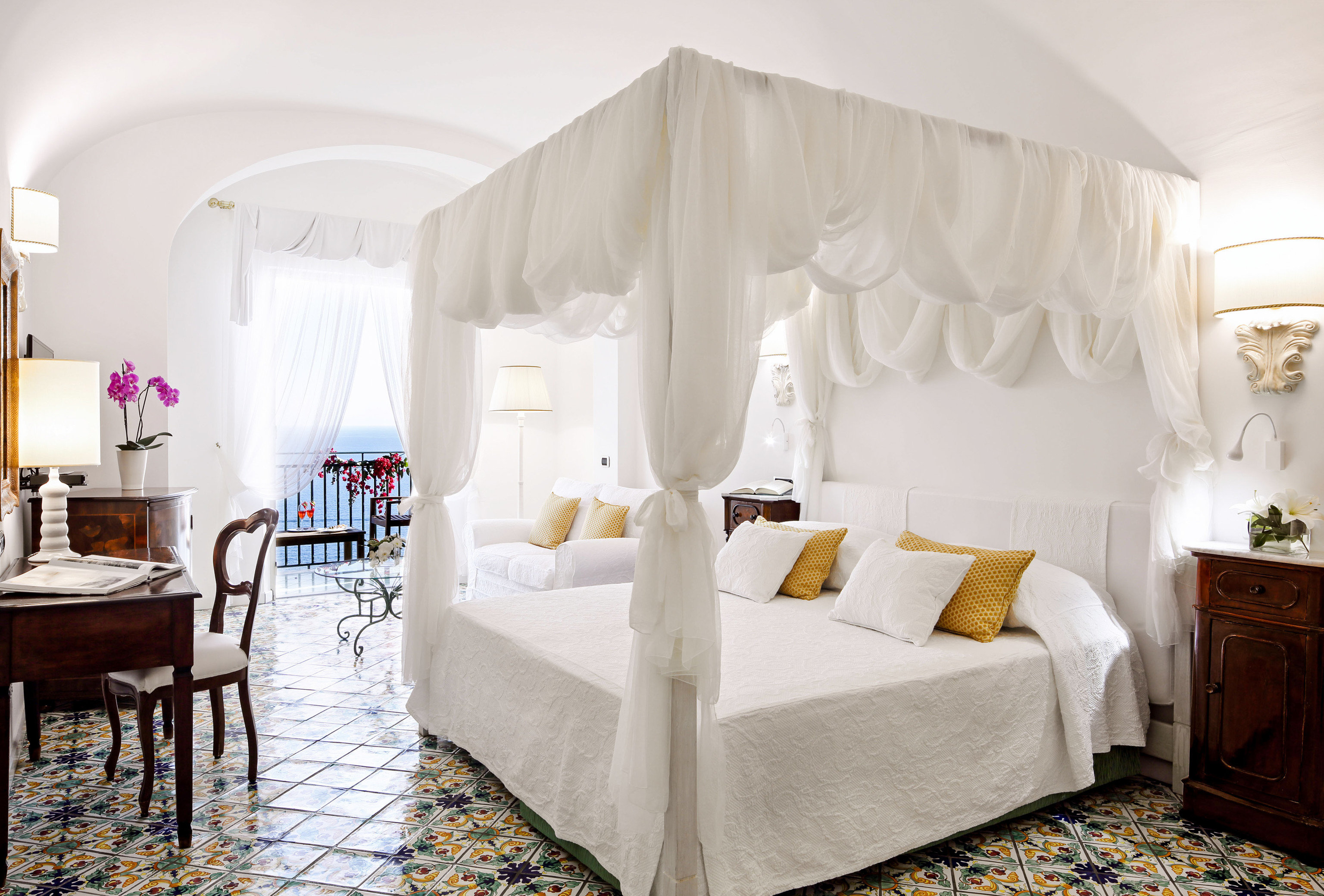 Suite Bedroom bed frame home window treatment curtain bedding living room interior designer mattress four poster