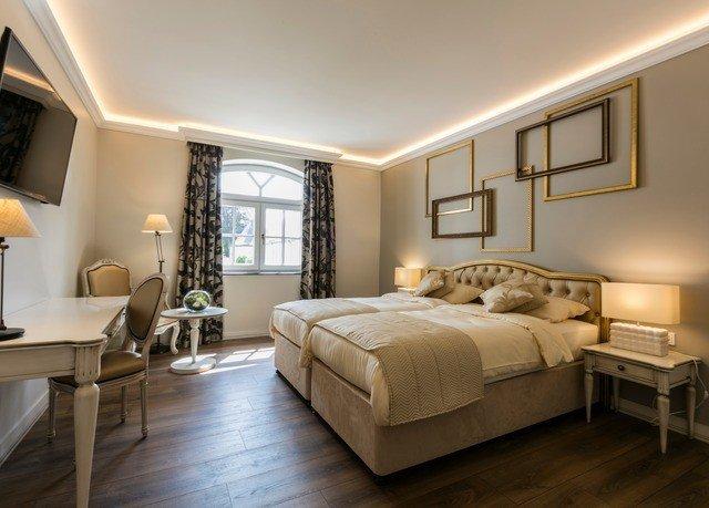 Bedroom property living room home hardwood Suite bed frame cottage wood flooring tan