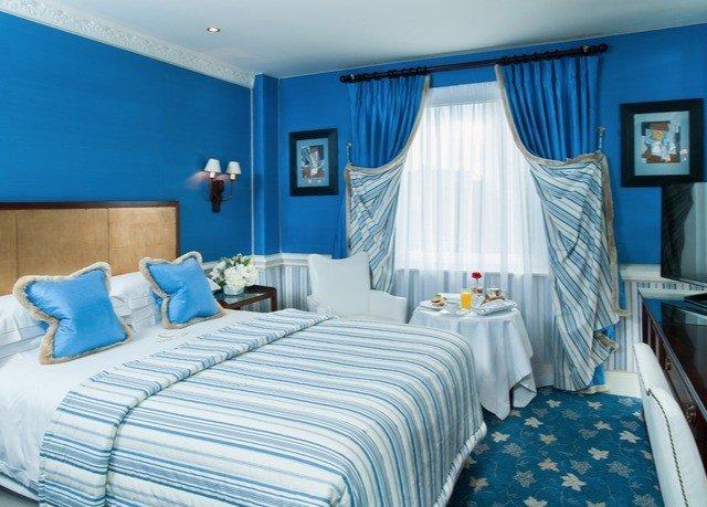Bedroom property scene blue Suite cottage bed sheet