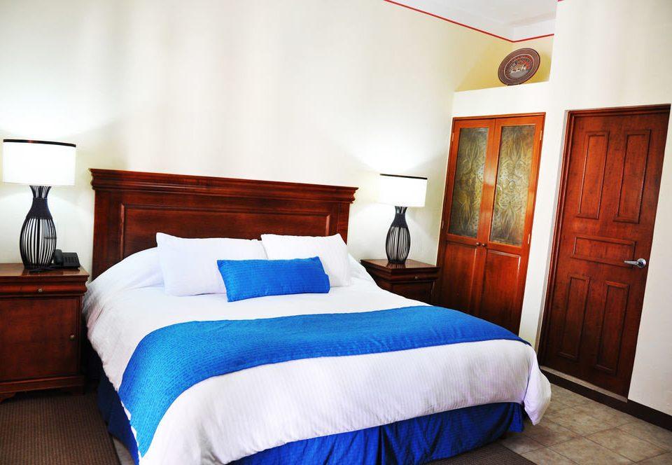 Bedroom property cottage Suite blue bed sheet
