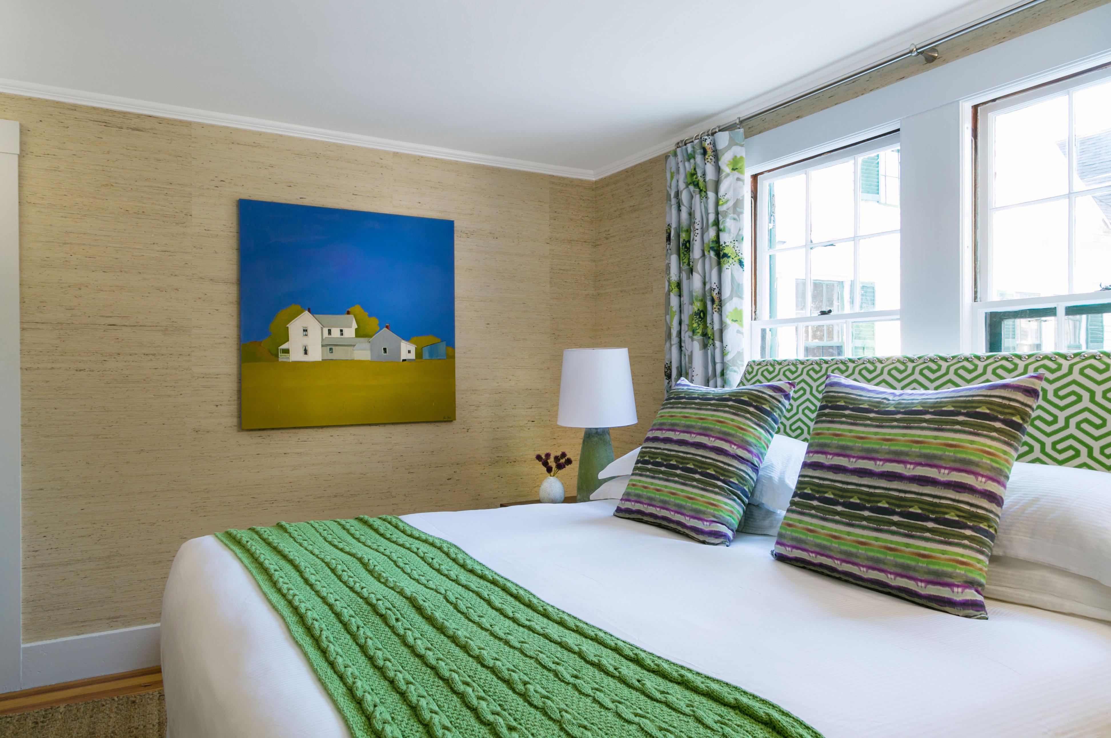 green sofa property Bedroom pillow condominium home Suite bed sheet living room