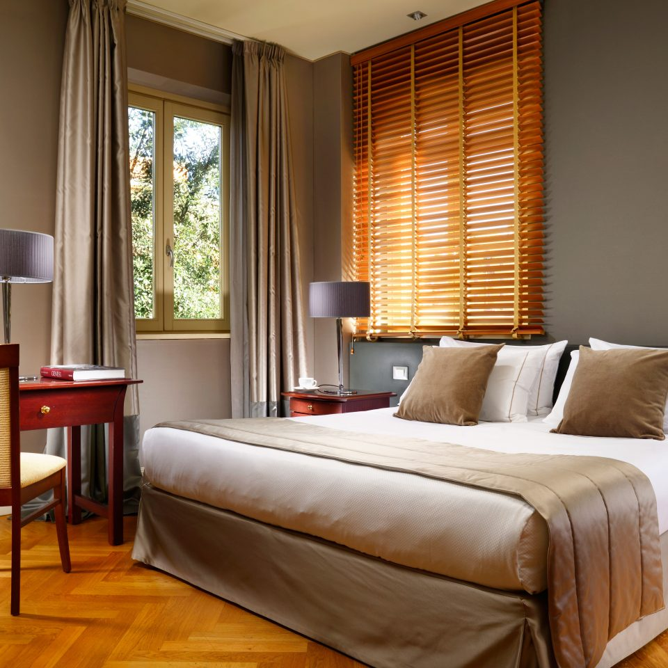 Bedroom sofa property living room Suite home hardwood bed sheet window treatment cottage containing