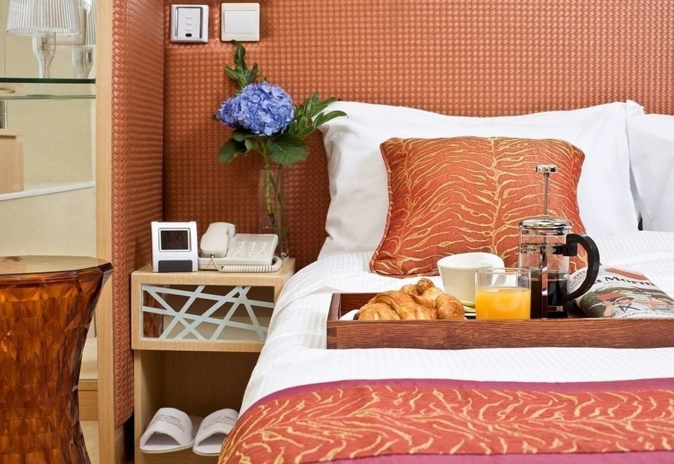 living room home bed sheet cottage orange Suite Bedroom containing