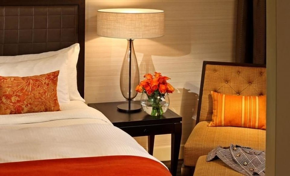 Suite cottage Bedroom hardwood lighting living room home bed sheet pillow orange