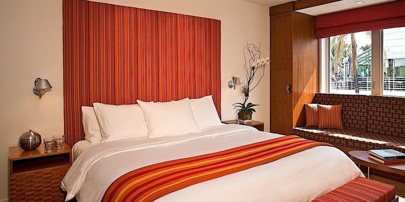 red sofa Bedroom property Suite curtain cottage bed sheet orange