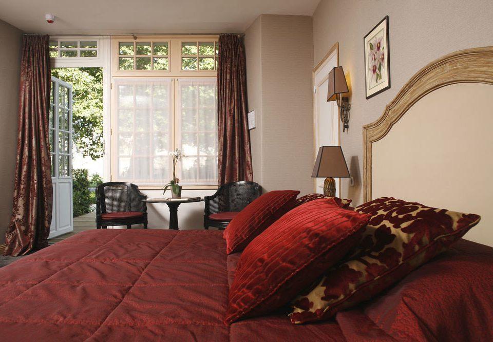 sofa red Bedroom property cottage Suite hardwood home bed sheet