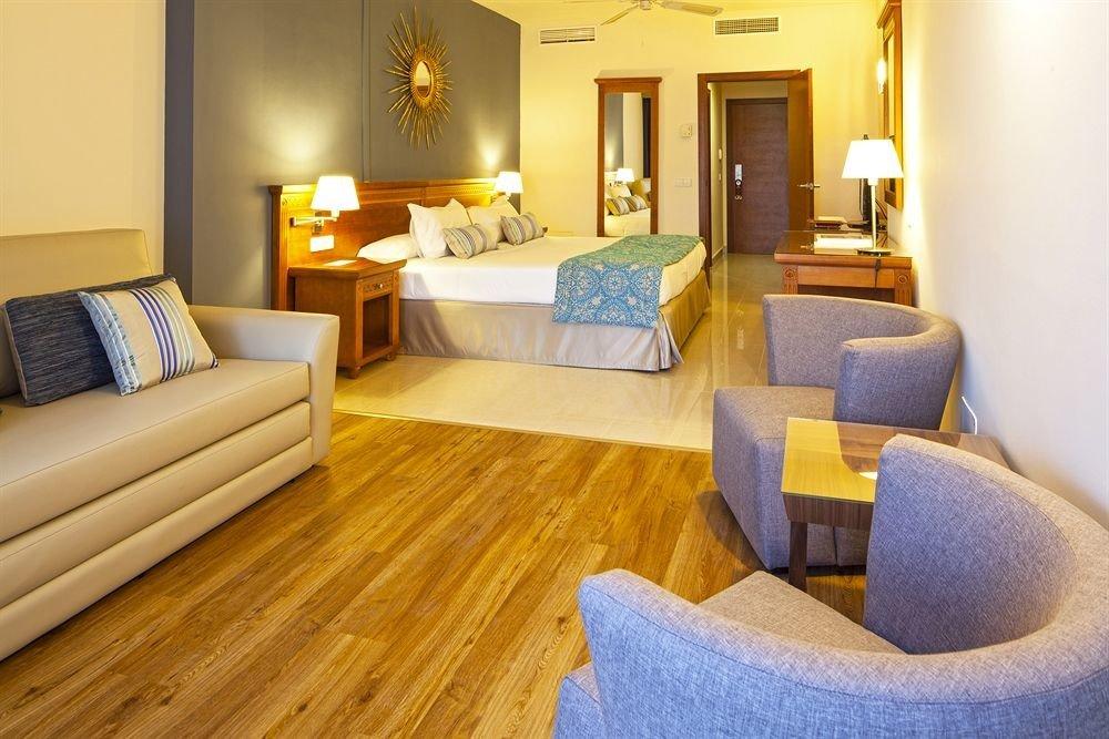 property Suite living room hardwood home cottage flooring wood flooring Bedroom bed sheet