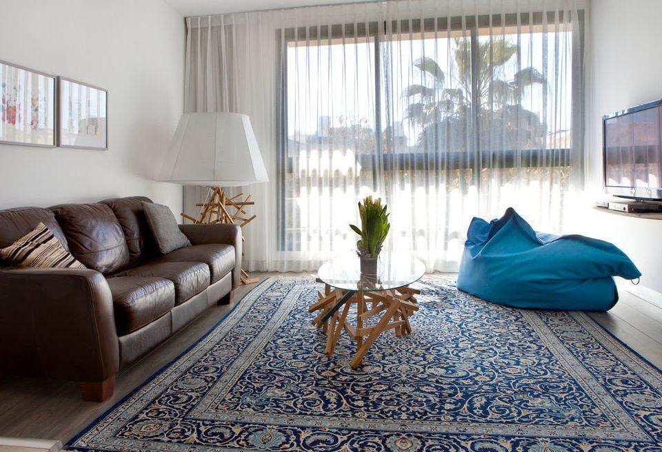 property living room Bedroom rug home hardwood flooring bed sheet Suite cottage