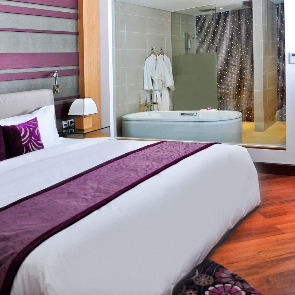 sofa property pillow Bedroom bed sheet hardwood Suite flooring purple textile cottage wood flooring laminate flooring
