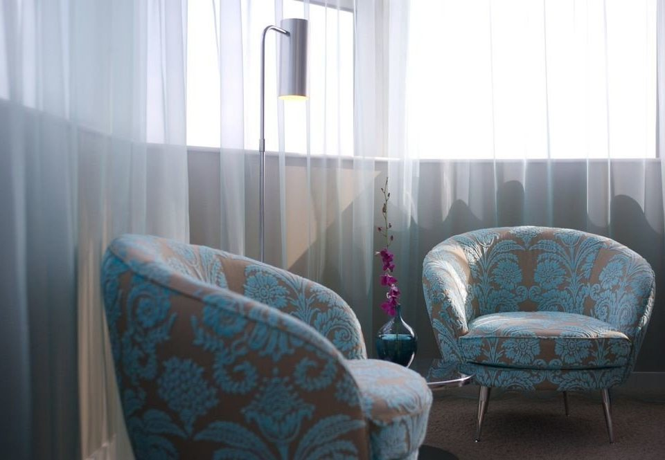 sofa chair blue property house home living room curtain Bedroom cottage Suite
