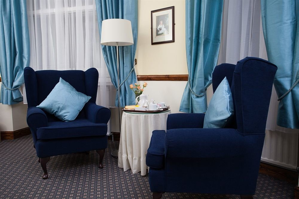 curtain color chair blue property living room house Suite home cottage Bedroom