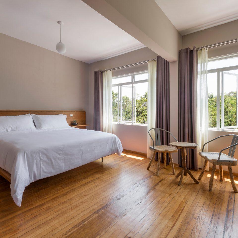 property building Bedroom hardwood wooden wood flooring home flooring living room laminate flooring condominium hard Suite cottage