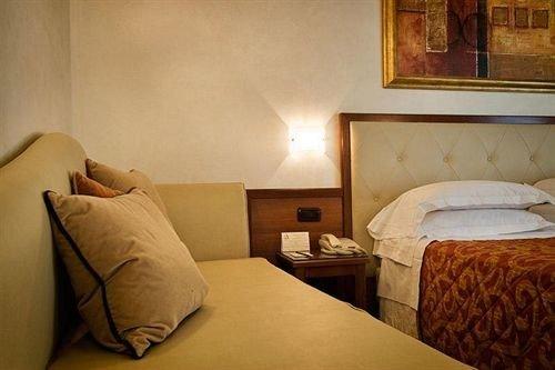 sofa property building Suite pillow Bedroom cottage lamp tan