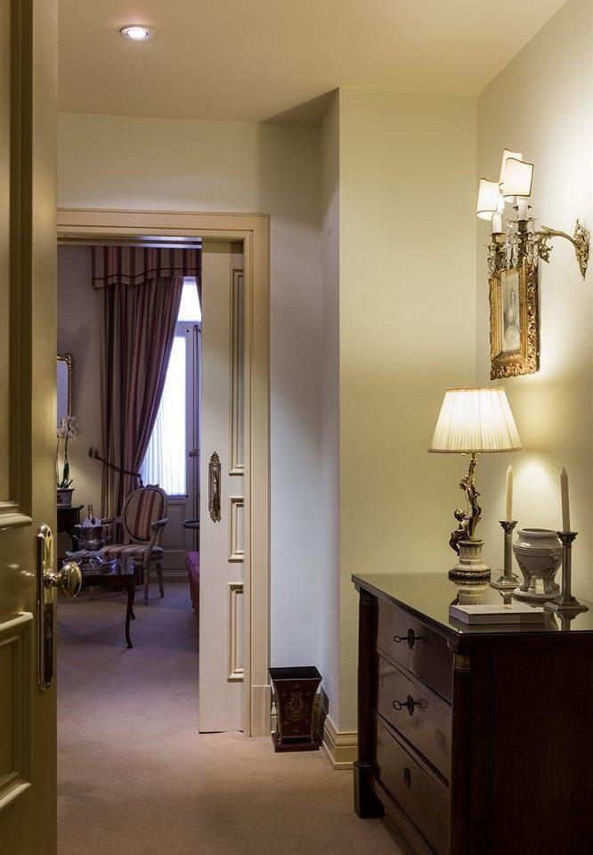 property home hardwood cabinetry lighting living room Bedroom hall Suite lamp
