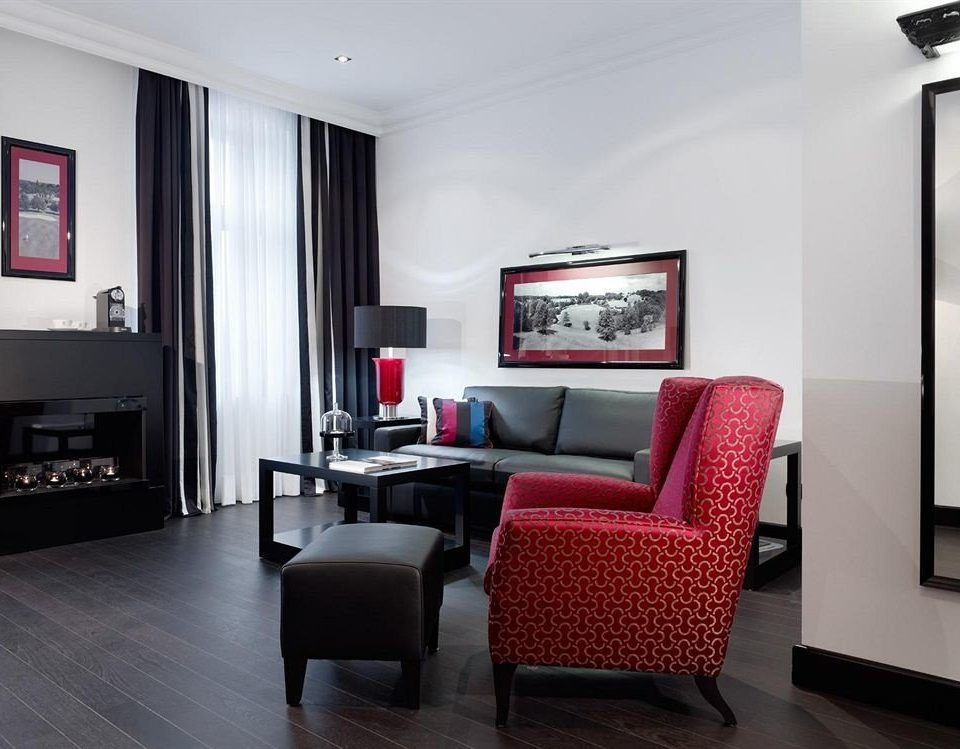 property living room chair red Suite condominium home Bedroom