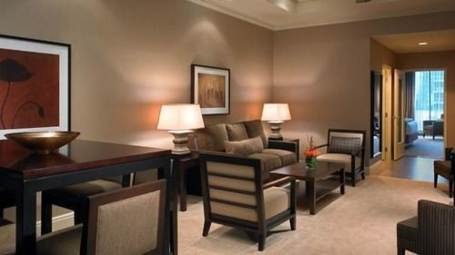 chair property Suite condominium Bedroom living room dining table