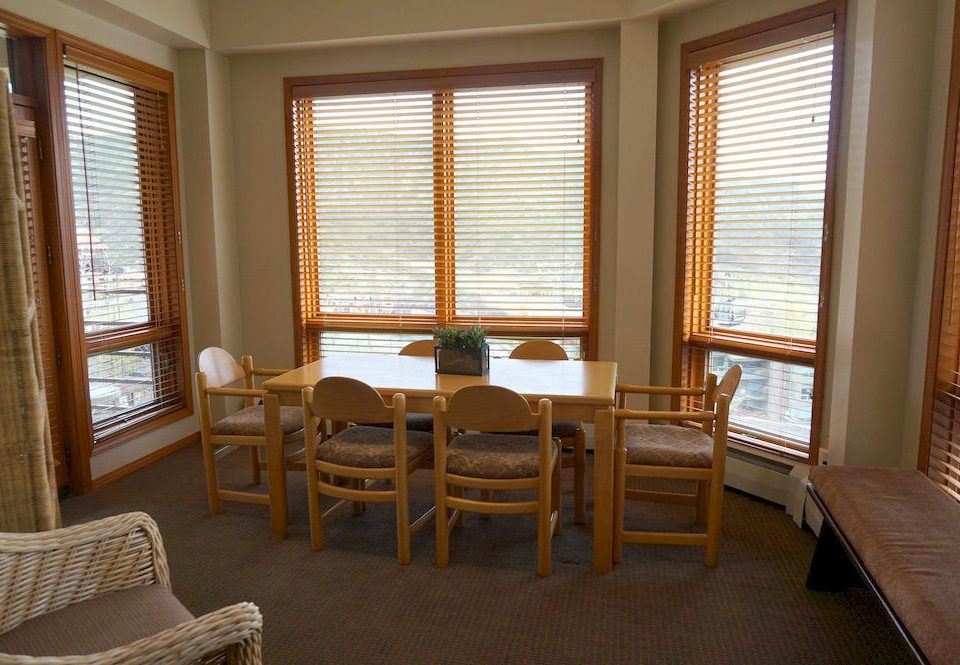 chair property living room Suite hardwood home window treatment Bedroom window blind cottage condominium