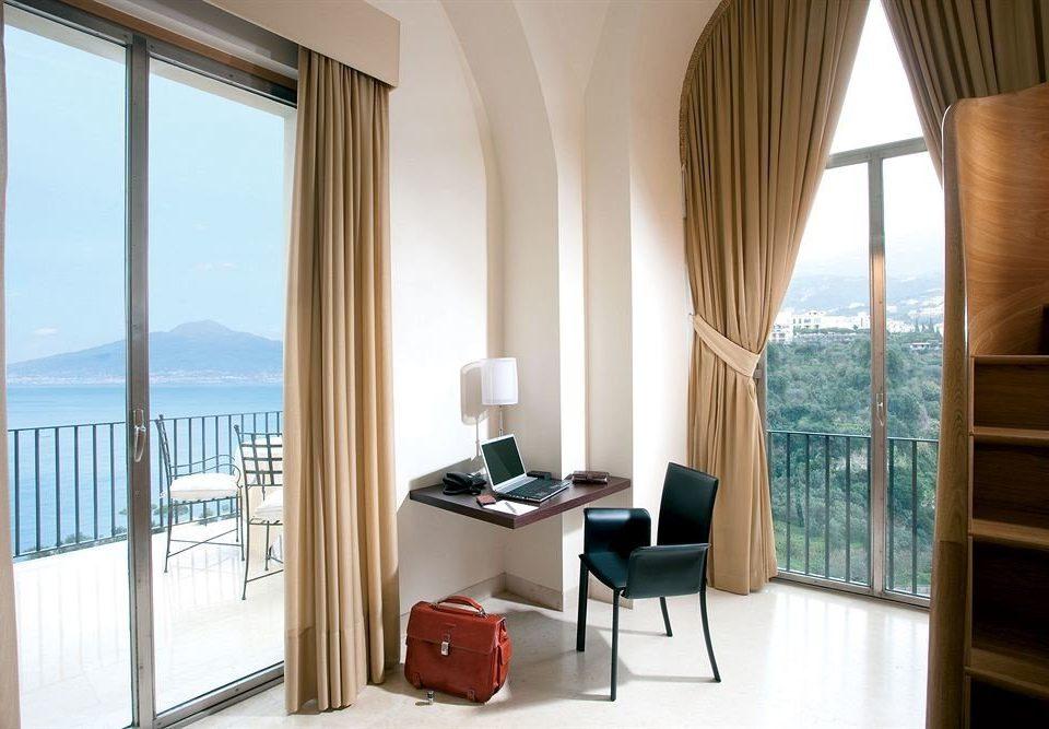 chair property Suite home condominium living room cottage Bedroom overlooking