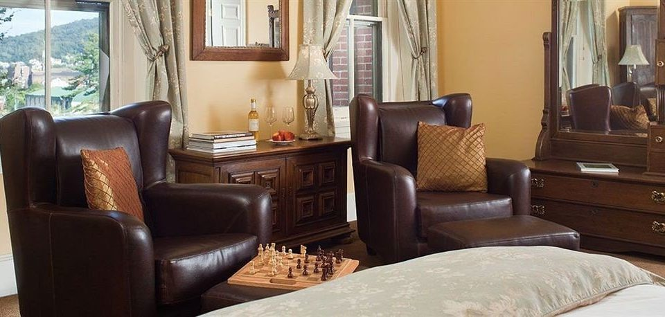 sofa living room property chair home Suite leather cottage Bedroom containing