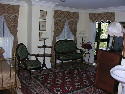 chair property cottage Suite home rug living room mansion Bedroom