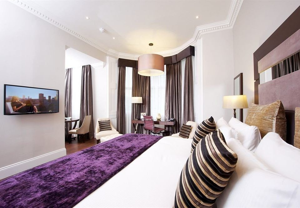 property Suite Bedroom living room purple flat clean