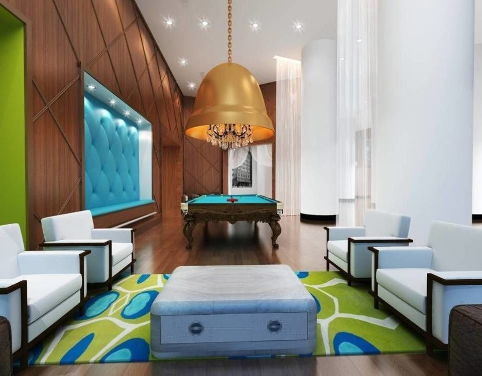 sofa property living room recreation room green Suite home condominium Bedroom leather colored