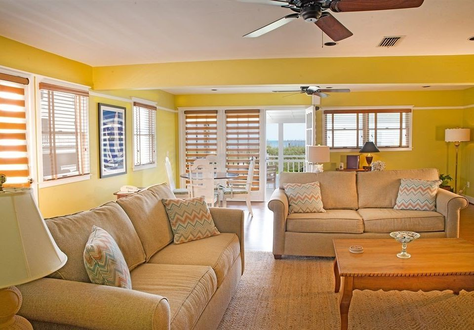 sofa living room yellow property home condominium cottage Bedroom Suite colored tan
