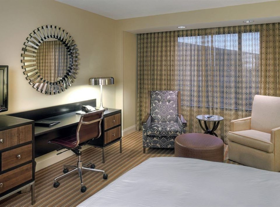 property living room condominium home hardwood cottage Suite flooring Bedroom containing flat