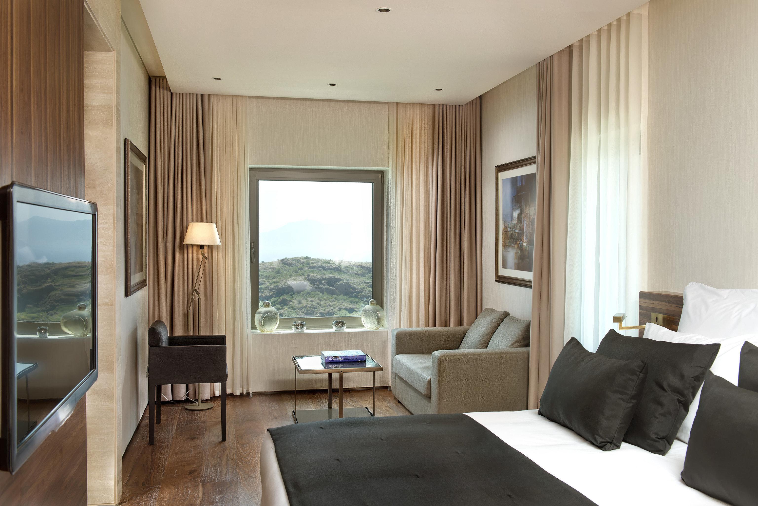 sofa property living room Suite condominium home Bedroom cottage