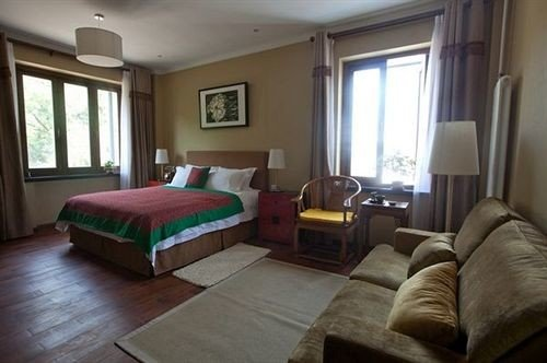 sofa property green cottage Suite Bedroom condominium living room